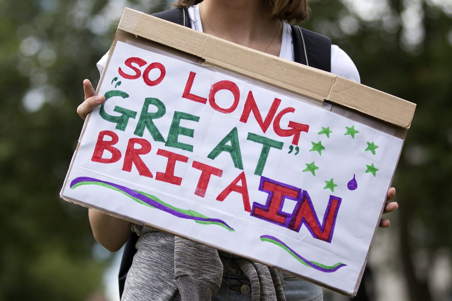 "A demonstrator holds a placard that reads ""So Long Great Britain"" during a protest against the pro-Brexit outcome of the UK's June 23 referendum on the European Union (EU), in central London on June 25, 2016. The result of Britain's June 23 referendum vote to leave the European Union (EU) has pitted parents against children, cities against rural areas, north against south and university graduates against those with fewer qualifications. London, Scotland and Northern Ireland voted to remain in the EU but Wales and large swathes of England, particularly former industrial hubs in the north with many disaffected workers, backed a Brexit. / AFP / JUSTIN TALLIS (Photo credit should read JUSTIN TALLIS/AFP/Getty Images)"