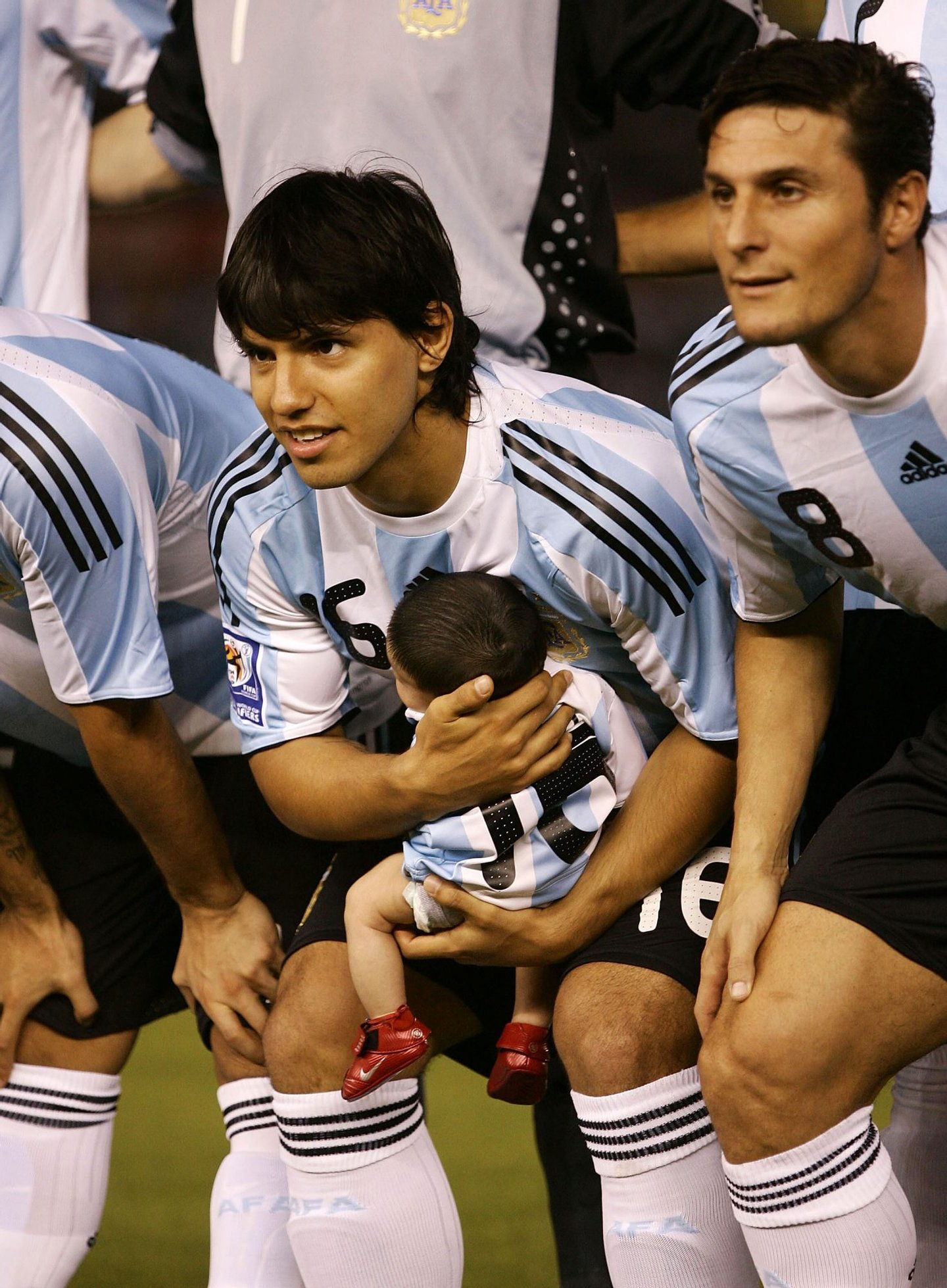 BUENOS AIRES, ARGENTINA - MARCH 28: Sergio Aguero of Argentina poses for photographs with his son Benjamin prior to the 2010 FIFA World Cup South African qualifier match between Argentina and Venezuela at River Plate Stadium on March 28, 2009 in Buenos Aires, Argentina. (Photo by Photogamma/Getty Images)