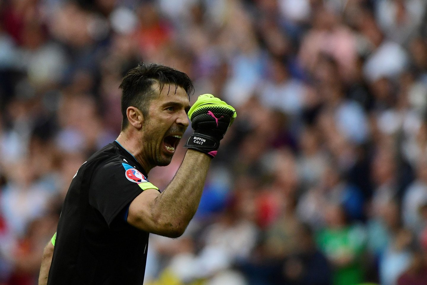 Italy's goalkeeper Gianluigi Buffon celebrates his team's win after the Euro 2016 round of 16 football match between Italy and Spain at the Stade de France stadium in Saint-Denis, near Paris, on June 27, 2016. Italy won the match 2:0. / AFP / PIERRE-PHILIPPE MARCOU (Photo credit should read PIERRE-PHILIPPE MARCOU/AFP/Getty Images)