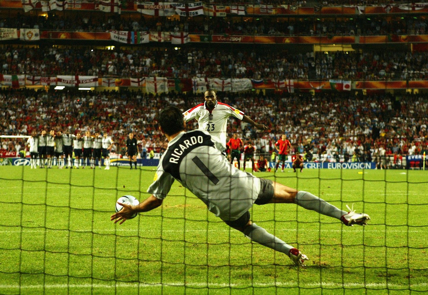 LISBON, PORTUGAL - JUNE 24: Darius Vassell of England has his penalty saved by goalkeeper Ricardo of Portugal during the UEFA Euro 2004 Quarter Final match between Portugal and England at the Luz Stadium on June 24, 2004 in Lisbon, Portugal. (Photo by Shaun Botterill/Getty Images)