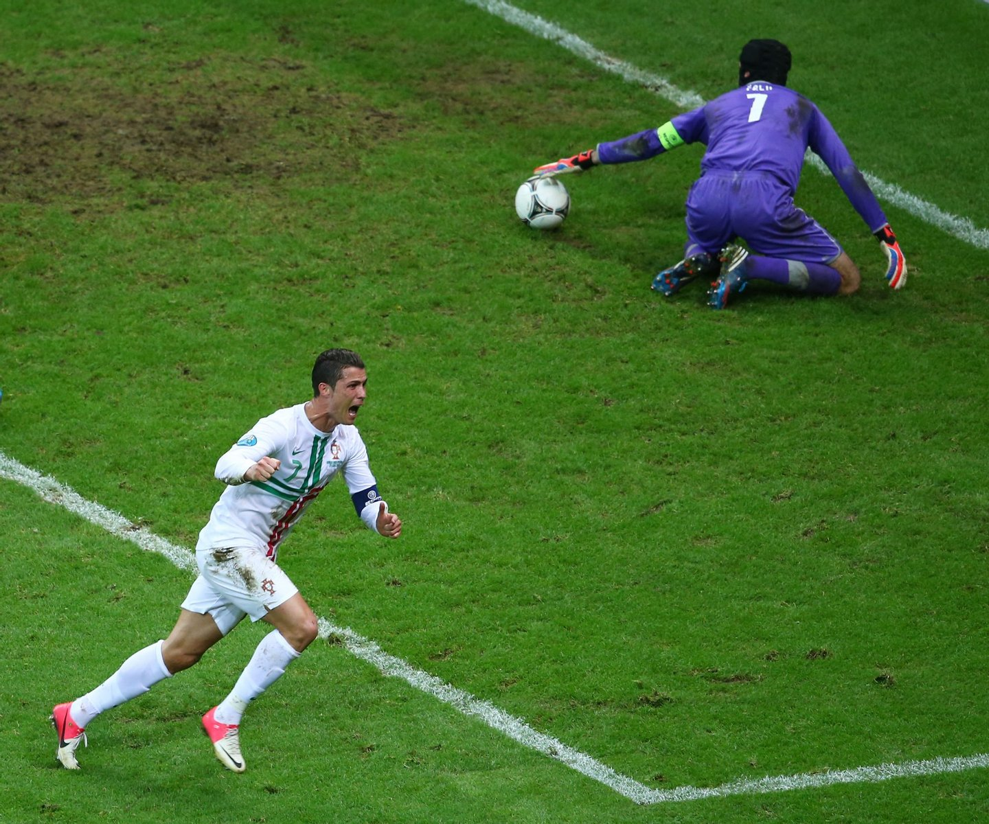 WARSAW, POLAND - JUNE 21: Cristiano Ronaldo of Portugal celebrates scoring the opening goal with a header past Petr Cech of Czech Republic during the UEFA EURO 2012 quarter final match between Czech Republic and Portugal at The National Stadium on June 21, 2012 in Warsaw, Poland. (Photo by Michael Steele/Getty Images)