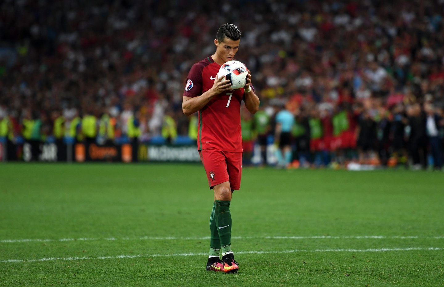 MARSEILLE, FRANCE - JUNE 30: Cristiano Ronaldo of Portugal kisses the ball at the penalty shootout during the UEFA EURO 2016 quarter final match between Poland and Portugal at Stade Velodrome on June 30, 2016 in Marseille, France. (Photo by Laurence Griffiths/Getty Images)