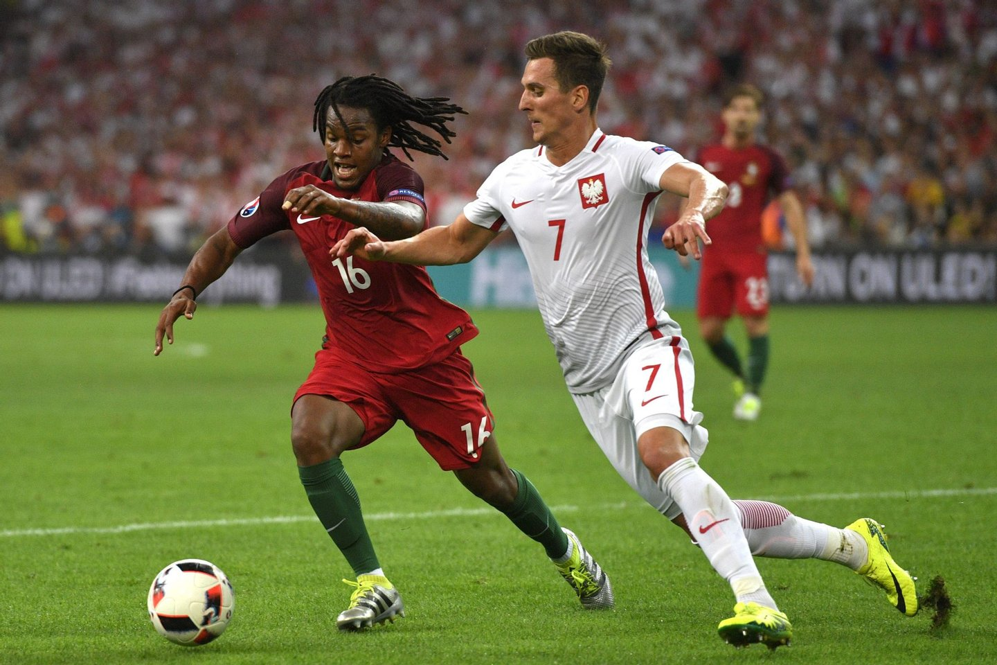 Portugal's midfielder Renato Sanches (L) vies with Poland's forward Arkadiusz Milik during the Euro 2016 quarter-final football match between Poland and Portugal at the Stade Velodrome in Marseille on June 30, 2016. / AFP / Francisco LEONG (Photo credit should read FRANCISCO LEONG/AFP/Getty Images)
