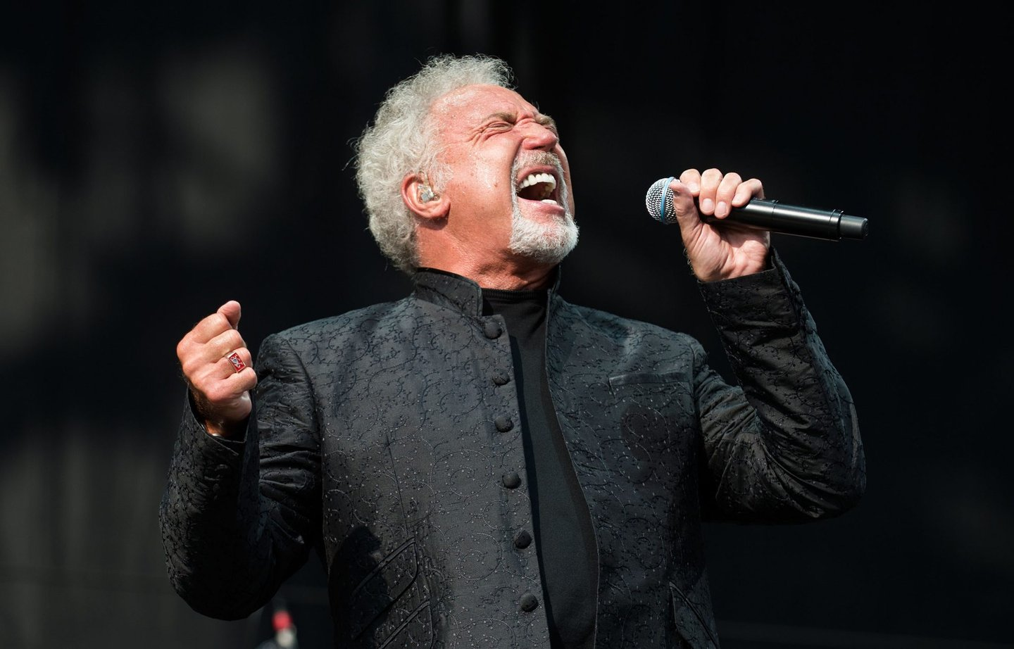 CHELMSFORD, ENGLAND - AUGUST 19: Tom Jones performs on the Virgin Media Stage on day 2 of the V Festival at Hylands Park on August 19, 2012 in Chelmsford, England. (Photo by Samir Hussein/Getty Images)