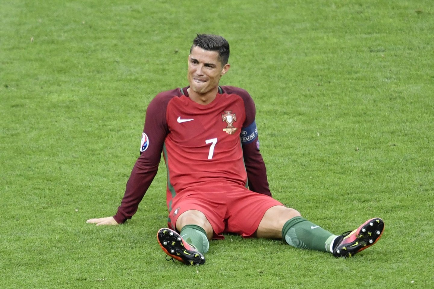Portugal's forward Cristiano Ronaldo reacts after an injury following a clash with France's forward Dimitri Payet (not pictured) during the Euro 2016 final football match between Portugal and France at the Stade de France in Saint-Denis, north of Paris, on July 10, 2016. / AFP / PHILIPPE LOPEZ (Photo credit should read PHILIPPE LOPEZ/AFP/Getty Images)