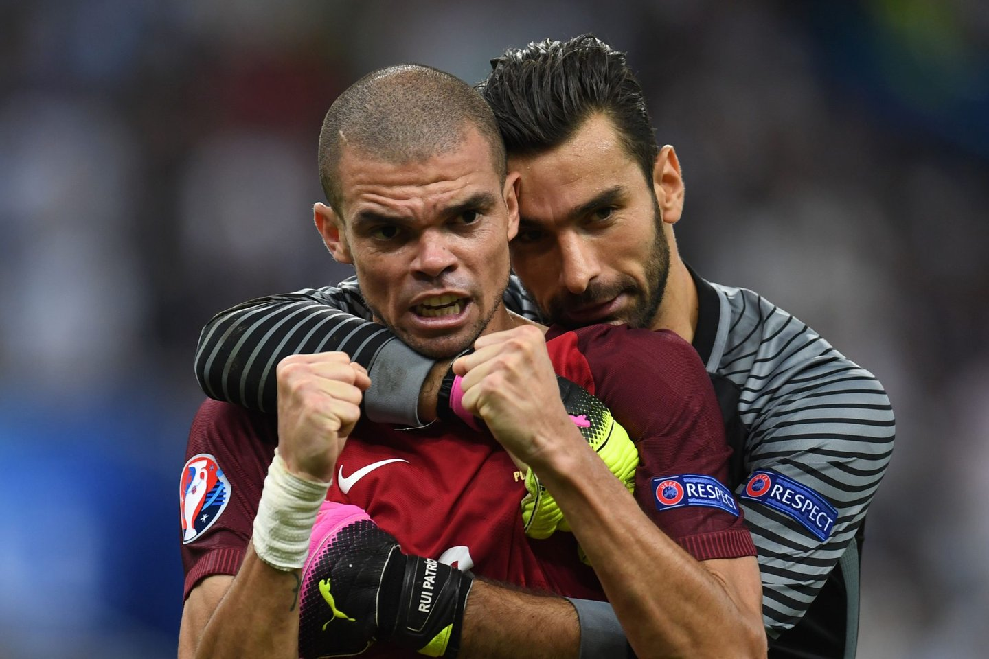 TOPSHOT - Portugal's defender Pepe (L) celebrates with Portugal's goalkeeper Rui Patricio during the Euro 2016 final football match between Portugal and France at the Stade de France in Saint-Denis, north of Paris, on July 10, 2016. / AFP / PATRIK STOLLARZ (Photo credit should read PATRIK STOLLARZ/AFP/Getty Images)
