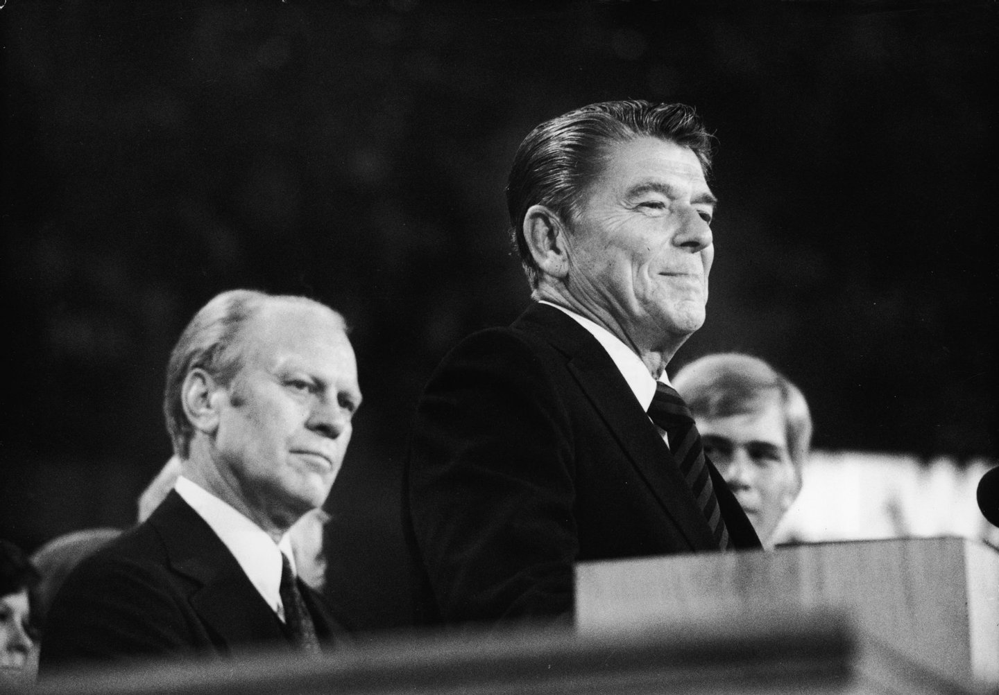 American president Gerald Ford (left) listens as future American president Ronald Reagan (1911 - 2004) delivers a speech during the closing session of the Republican National Convention, Kansas City, Missouri, August 19, 1976. (Photo by Hulton Archive/Getty Images)