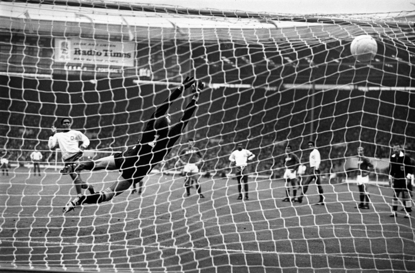 29th July 1966: Portugal's Eusebio (white shirt) hammers his penalty kick past Russia's Lev Yashin, to put his country in the lead during the World Cup third place play off game at Wembley Stadium. (Photo by Keystone/Getty Images)