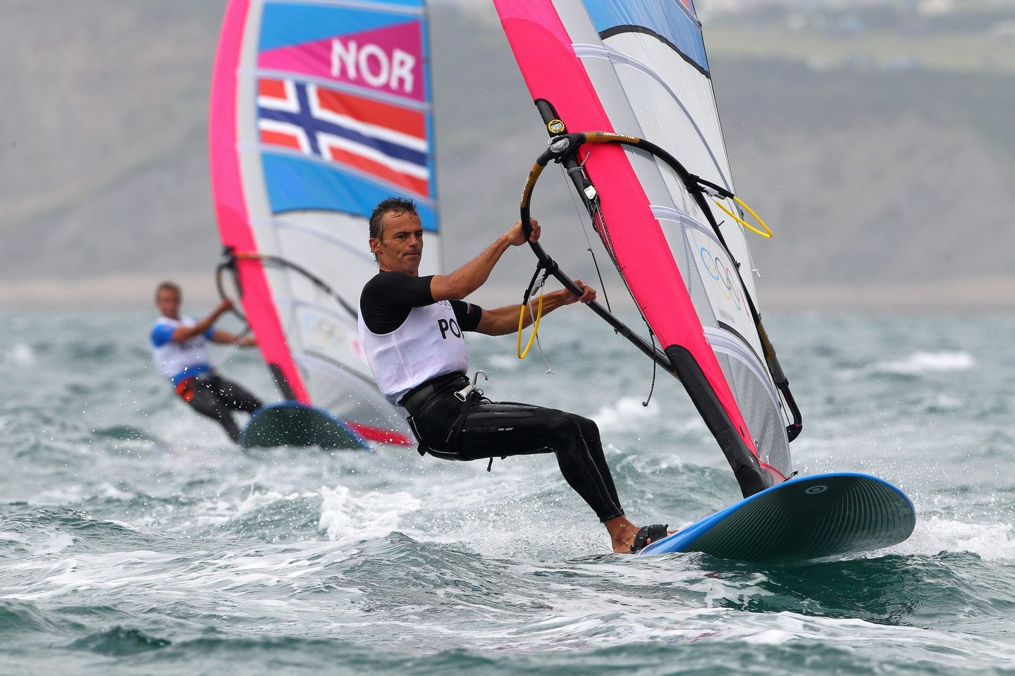 WEYMOUTH, ENGLAND - JULY 31: Joao Rodrigues of Portugal competes in the Men's RS:X Sailing on Day 4 of the London 2012 Olympic Games at the Weymouth & Portland Venue at Weymouth Harbour on July 31, 2012 in Weymouth, England. (Photo by Richard Langdon/Getty Images)