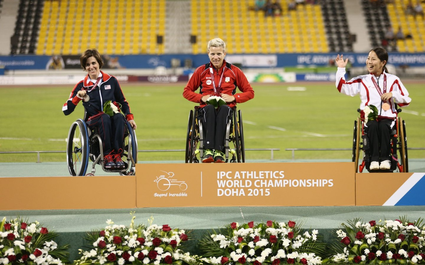 DOHA, QATAR - OCTOBER 26: Marieke Vervoort of Belgium poses with her gold medal, Kerry Morgan of USA silver and Yuka Kiyama of Japan bronze after the women's 100m T52 final during the Evening Session on Day Five of the IPC Athletics World Championships at Suhaim Bin Hamad Stadium on October 26, 2015 in Doha, Qatar. (Photo by Warren Little/Getty Images)