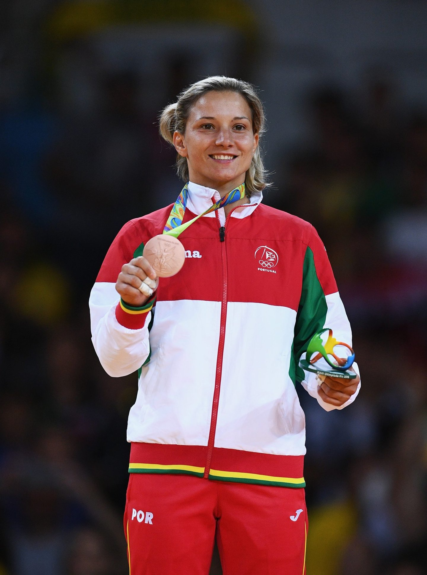 RIO DE JANEIRO, BRAZIL - AUGUST 08: Bronze medalist Telma Monteiro celebrates on the podium after the Women's -57 kg Judo Contest on Day 3 of the Rio 2016 Olympic Games at Carioca Arena 2 on August 8, 2016 in Rio de Janeiro, Brazil. (Photo by David Ramos/Getty Images)