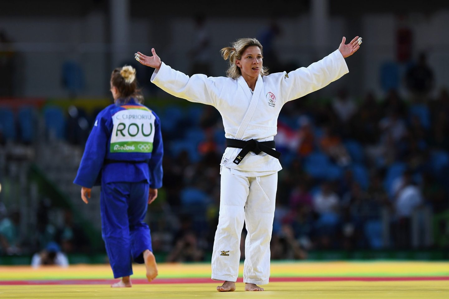 RIO DE JANEIRO, BRAZIL - AUGUST 08: Telma Monteiro of Portugal (white) celebrates after defeating Corina Caprioriu of Romania in the Women's -57 kg Contest for Bronze Medal A on Day 3 of the Rio 2016 Olympic Games at Carioca Arena 2 on August 8, 2016 in Rio de Janeiro, Brazil. (Photo by David Ramos/Getty Images)