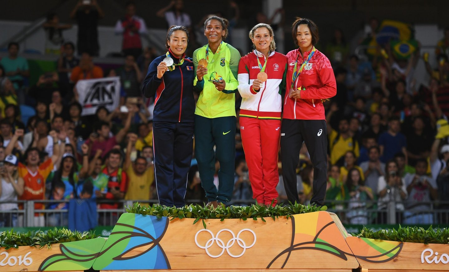 RIO DE JANEIRO, BRAZIL - AUGUST 08: Silver medalist Sumiya Dorjsuren of Mongolia, gold medalist Rafaela Silva of Brazil, bronze medalist Telma Monteiro of Portugal and bronze medalist Kaori Matsumoto of Japan celebrate on the podium after the Women's -57 kg Judo Contest on Day 3 of the Rio 2016 Olympic Games at Carioca Arena 2 on August 8, 2016 in Rio de Janeiro, Brazil. (Photo by David Ramos/Getty Images)