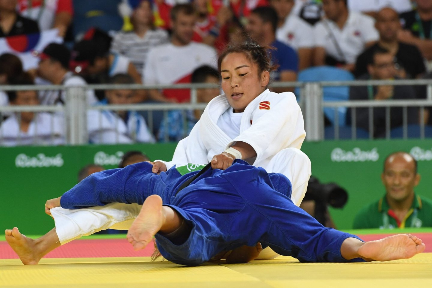Mongolia's Sumiya Dorjsuren (white) competes with Portugal's Telma Monteiro during their women's -57kg judo contest quarterfinal match of the Rio 2016 Olympic Games in Rio de Janeiro on August 8, 2016. / AFP / Toshifumi KITAMURA (Photo credit should read TOSHIFUMI KITAMURA/AFP/Getty Images)