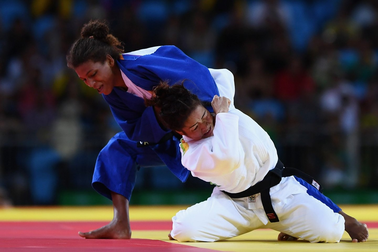 RIO DE JANEIRO, BRAZIL - AUGUST 08: Rafaela Silva of Brazil (blue) competes against Sumiya Dorjsuren of Mongolia in the Women's -57 kg Final - Gold Medal Contest on Day 3 of the Rio 2016 Olympic Games at Carioca Arena 2 on August 8, 2016 in Rio de Janeiro, Brazil. (Photo by David Ramos/Getty Images)