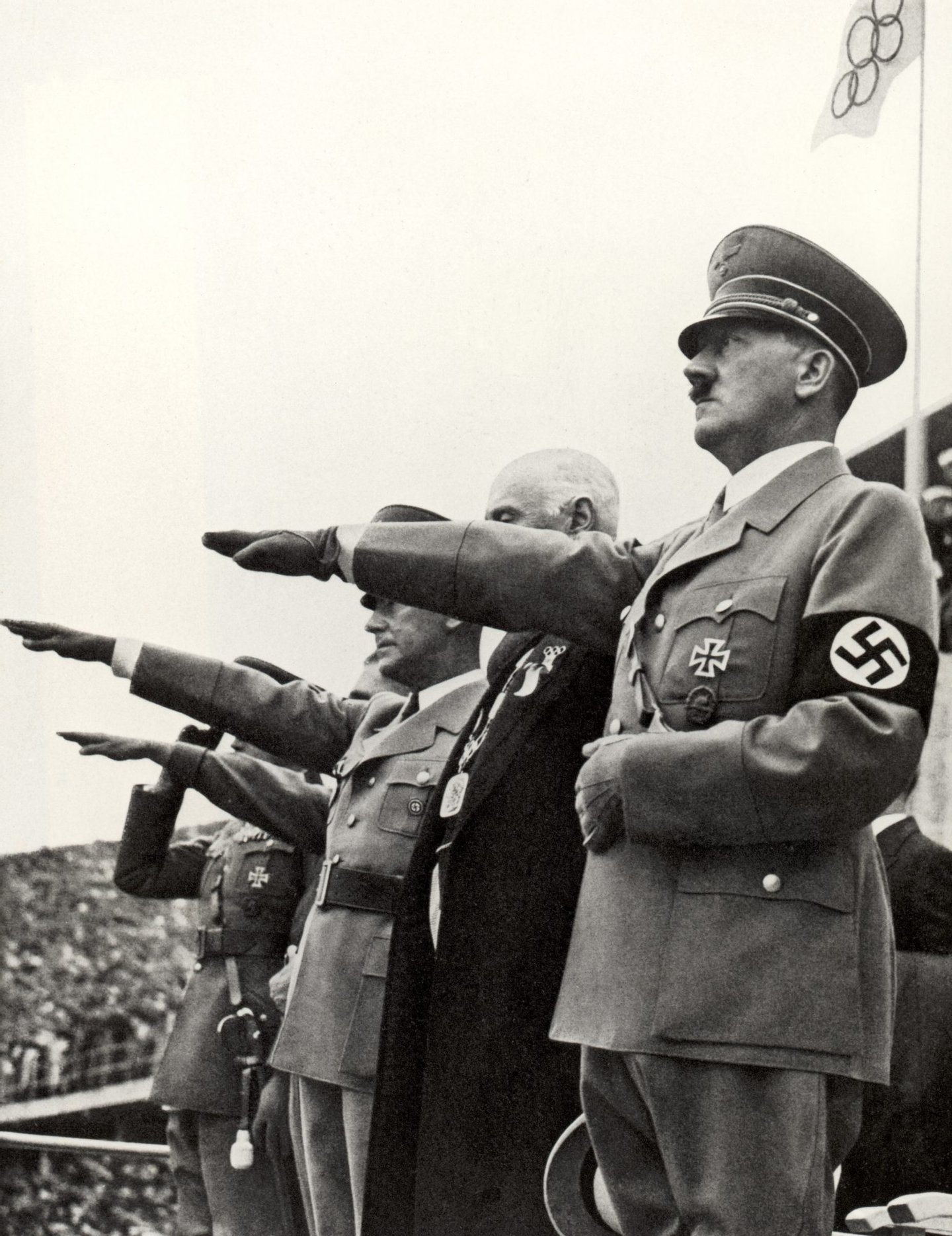 BERLIN - AUGUST 1: Adolf Hitler and his staff salute the teams during the opening ceremonies of the XI Olympic Games on August 1, 936 in Berlin, Germany. (Photo by Getty Images)