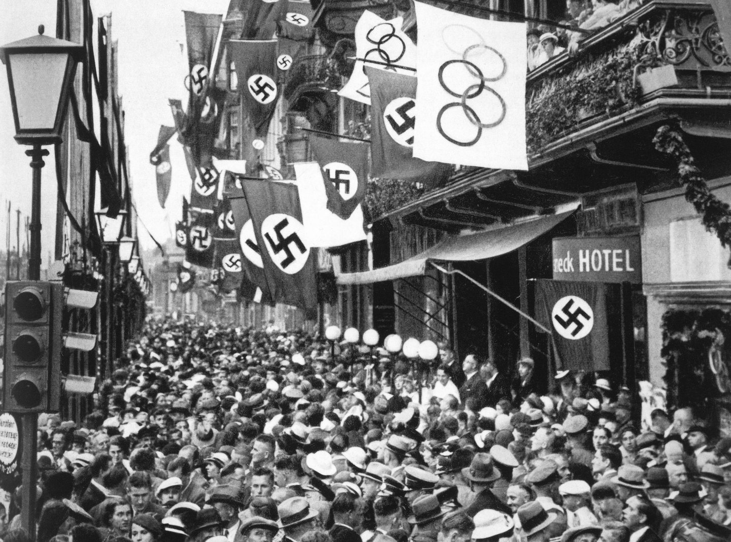 BERLIN - 1936: General view of crowd on a street in Berlin as Germany hosts the XI Olympic Games in August of 1936 in Berlin, Germany. (Photo by Getty Images)
