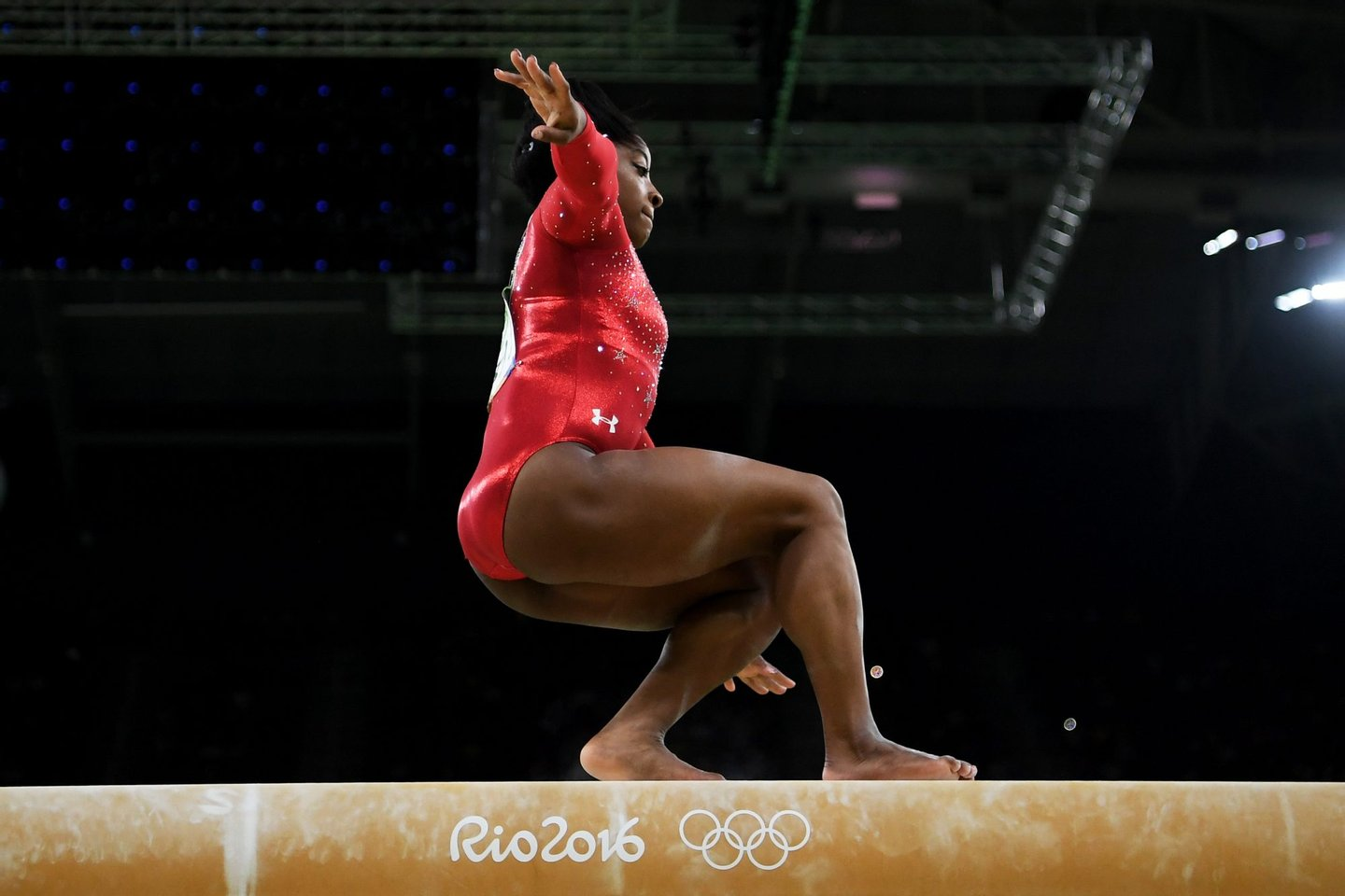RIO DE JANEIRO, BRAZIL - AUGUST 15: Simone Biles of the United States slips while competing in the Balance Beam Final on day 10 of the Rio 2016 Olympic Games at Rio Olympic Arena on August 15, 2016 in Rio de Janeiro, Brazil. (Photo by Laurence Griffiths/Getty Images)