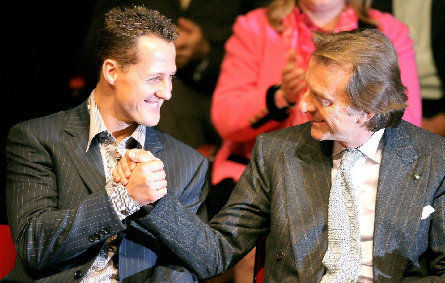 Maranello, ITALY: Retired Ferrari F1 driver Micheal Schumacher of Germany (L), is congratulated by Ferrari President Luca Cordero di Montezemolo after he collected the town of Maranello's Honorary Citizenship, 05 December 2006 during a ceremony at the Enzo Ferrari Auditorium in Maranello. The town's governing council unanimously voted last week to bestow the honor on the German driver above all for winning five titles with Ferrari and helping it clinch six consecutive constructors' championships. AFP PHOTO / FILIPPO MONTEFORTE (Photo credit should read FILIPPO MONTEFORTE/AFP/Getty Images)