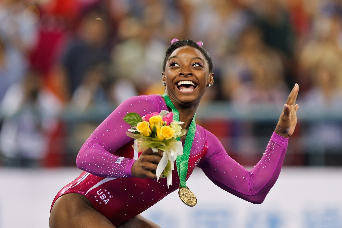 NANNING, CHINA - OCTOBER 10: Gold medalist Simone Biles of United States scared form a bee fly during the medal ceremony after the Women's All-Around Final in day four of the 45th Artistic Gymnastics World Championships at Guangxi Sports Center Stadium on October 10, 2014 in Nanning, China. (Photo by Lintao Zhang/Getty Images)