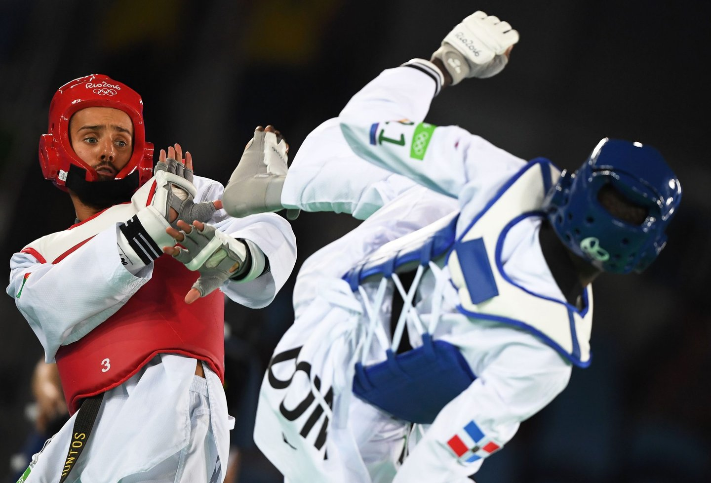 Portugal's Rui Braganca (L) competes against Dominican Republic's Luisito Pie during their men's taekwondo quarter-final bout in the -68kg category as part of the Rio 2016 Olympic Games, on August 18, 2016, at the Carioca Arena 3, in Rio de Janeiro. / AFP / Kirill KUDRYAVTSEV (Photo credit should read KIRILL KUDRYAVTSEV/AFP/Getty Images)