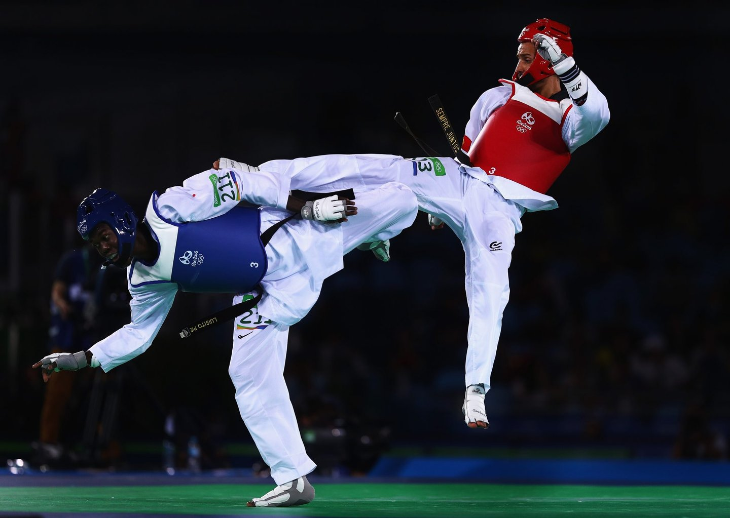 RIO DE JANEIRO, BRAZIL - AUGUST 17: Rui Braganca of Portugal kicks Luisito Pie of the Dominican Republic during the Taekwondo Men's -58kg Quarter Final contest at Cairoca Arena 3 on August 18, 2016 in Rio de Janeiro, Brazil. (Photo by Ryan Pierse/Getty Images)