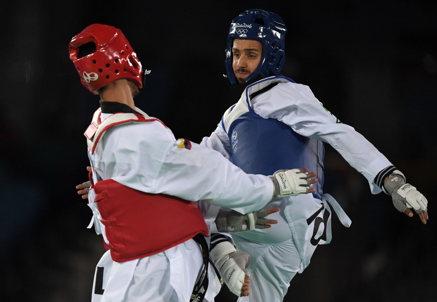 Portugal's Rui Braganca (R) competes against Colombia's Oscar Luis Munoz Oviedo during their men's taekwondo qualifying bout in the -58kg category as part of the Rio 2016 Olympic Games, on August 17, 2016, at the Carioca Arena 3, in Rio de Janeiro. / AFP / Ed JONES (Photo credit should read ED JONES/AFP/Getty Images)