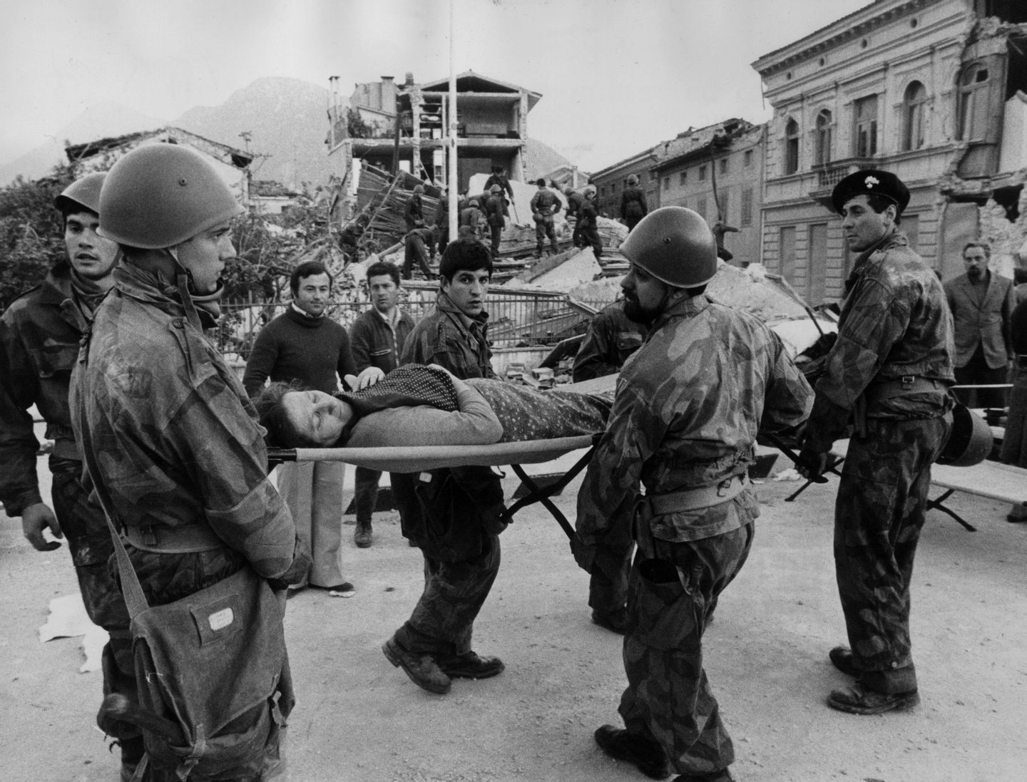 May 1976: Italian soldiers carry a woman on a stretcher to a place of safety after she was dug from the remains of her home after an earthquake in Udine which killed over a 1,000 people. (Photo by Livio Fioroni/Keystone/Getty Images)