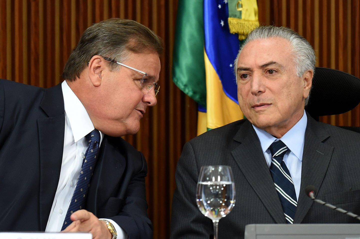 Brazilian acting President Michel Temer (R) and the General Secretary of the Brazilian Presidency Geddel Vieira Lima speak during a meeting with party leaders of the National Congress at Planalto Palace in Brasilia, on June 15, 2016. Temer is seeking support for the approval of a fiscal adjustment that he will send this week to the Congress. / AFP / EVARISTO SA (Photo credit should read EVARISTO SA/AFP/Getty Images)