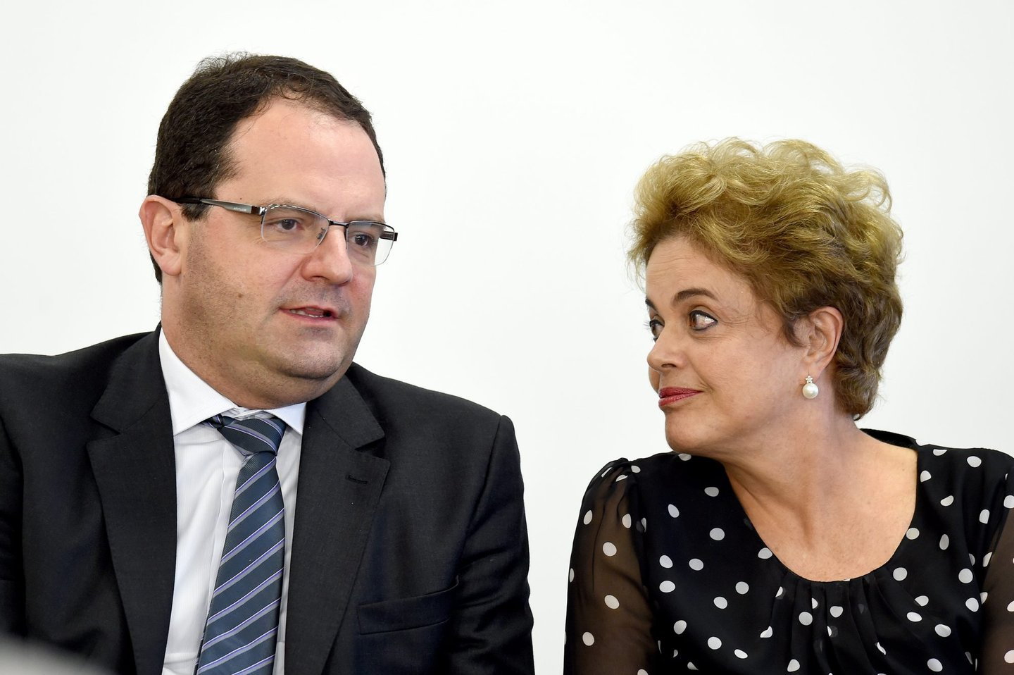 "Brazilian President Dilma Rousseff (R) talks to her Finance Minister Nelson Barbosa during a ceremony to renovate the leasing contract regarding the use of the Paranagua Container Terminal, at Planalto Palace in Brasilia, on April 13, 2016. Brazil's President Dilma Rousseff vowed Wednesday she will ""fight to the last minute"" against efforts to impeach her, despite key allies deserting her as she clings to office. Lawmakers will hold a crucial vote on impeachment proceedings against Rousseff in congress on Sunday. / AFP / EVARISTO SA (Photo credit should read EVARISTO SA/AFP/Getty Images)"