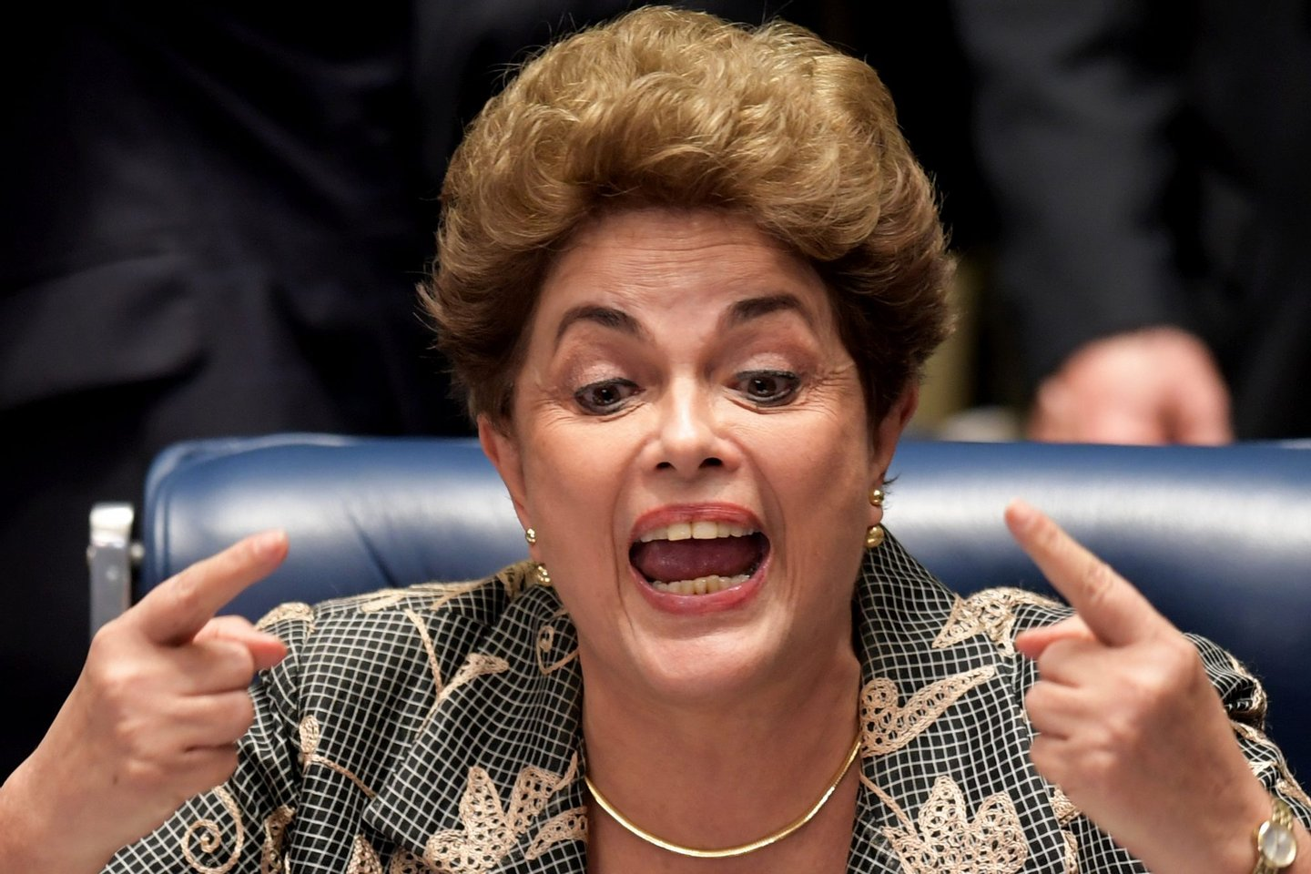 "Suspended Brazilian President Dilma Rousseff gestures during her testimony in her impeachment trial at the National Congress in Brasilia on August 29, 2016. Rousseff told senators in emotional, combative testimony at her trial Monday that voting for her impeachment would amount to a ""coup d'etat."" / AFP / EVARISTO SA (Photo credit should read EVARISTO SA/AFP/Getty Images)"