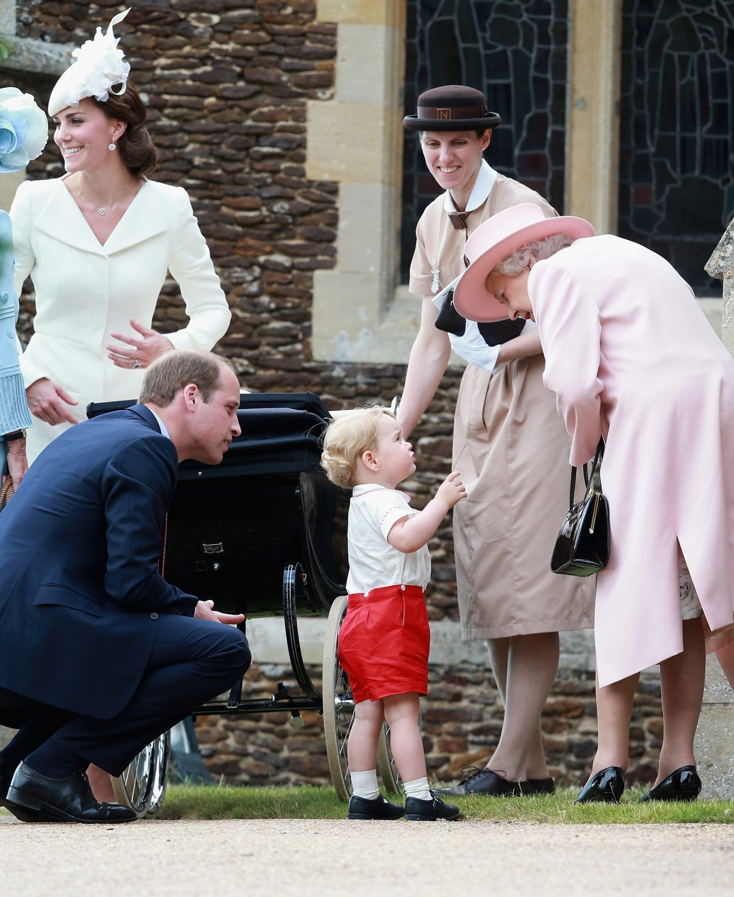 KING'S LYNN, ENGLAND - JULY 05: Catherine, Duchess of Cambridge, Prince William, Duke of Cambridge, Princess Charlotte of Cambridge and Prince George of Cambridge, Queen Elizabeth II and Prince George's nanny, Maria Teresa Turrion Borrallo leave the Church of St Mary Magdalene on the Sandringham Estate for the Christening of Princess Charlotte of Cambridge on July 5, 2015 in King's Lynn, England. (Photo by Chris Jackson - WPA Pool / Getty Images)