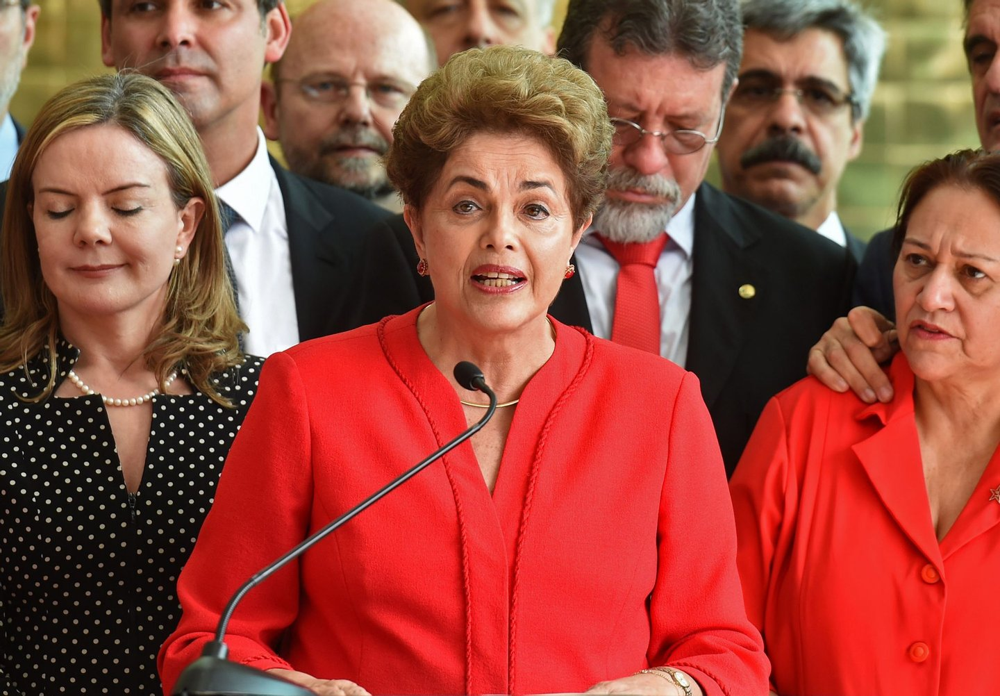 Brazil's former Dilma Rousseff speaks at the Alvorada presidential palace in Brasilia after she was stripped of the country's presidency in a Senate impeachment vote on August 31, 2016. Rousseff was stripped of the country's presidency Wednesday in a Senate impeachment vote ending 13 years of leftist rule in Latin America's biggest economy. Rousseff, 68, was convicted by 61 of the 81 senators of illegally manipulating the national budget. The vote, passing the needed two-thirds majority, meant she was immediately removed from office. / AFP / EVARISTO SA (Photo credit should read EVARISTO SA/AFP/Getty Images)