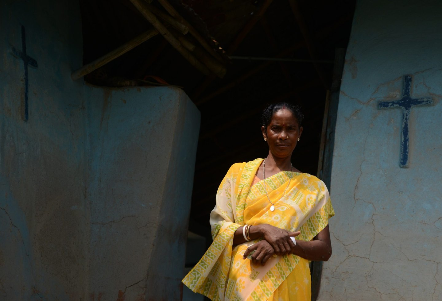 "In this photograph taken on September 1, 2016, Indian woman Monica Besra poses at her home village of Nakur in Danogram, 500 kilometres (310 miles) from the eastern city of Kolkata. Besra, a Bengali tribal woman, became an overnight sensation in September 1998 when she alleged that a picture and a medallion of Mother Teresa had cured a cancerous tumour. Known as the ""Angel of Mercy"" for serving the poor in India, Mother Teresa will be declared a saint on September 4, amid great fanfare. But as the Vatican prepares her canonisation, allegations of fraud and medical negligence cloud her legacy. / AFP / Diptendu DUTTA / TO GO WITH AFP STORY: India-belief-religion-health, by Annie Banerji (Photo credit should read DIPTENDU DUTTA/AFP/Getty Images)"