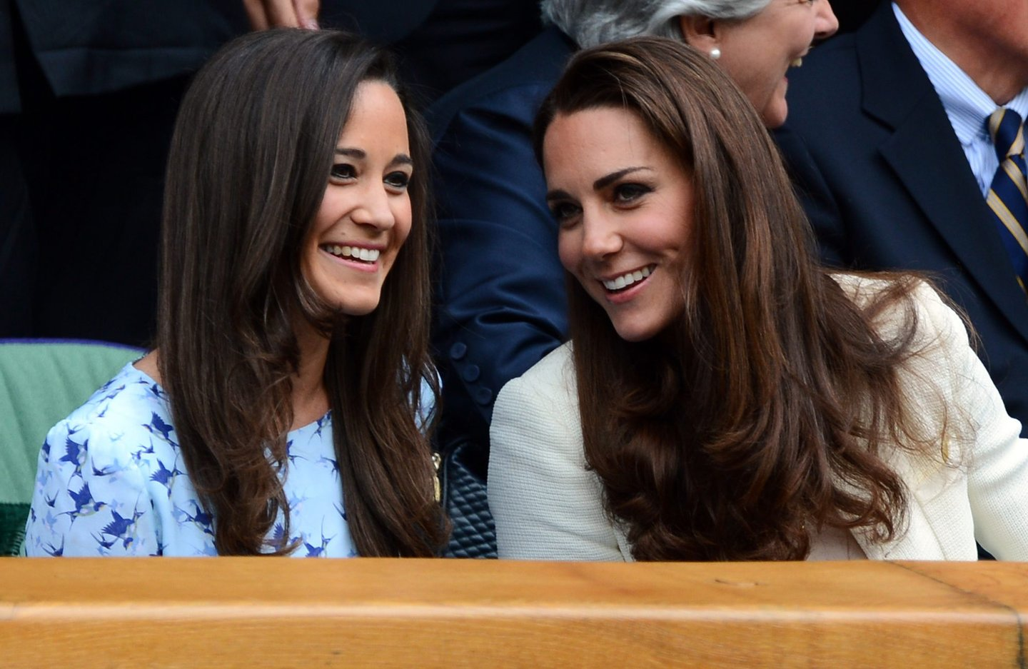 Catherine, Duchess of Cambridge (R) and her sister Pippa Middleton talk in the Royal Box before the men's singles final match between Britain's Andy Murray and Switzerland's Roger Federer on Centre Court on day 13 of the 2012 Wimbledon Championships tennis tournament at the All England Tennis Club in Wimbledon, southwest London, on July 8, 2012. AFP PHOTO / LEON NEAL RESTRICTED TO EDITORIAL USE (Photo credit should read LEON NEAL/AFP/GettyImages)