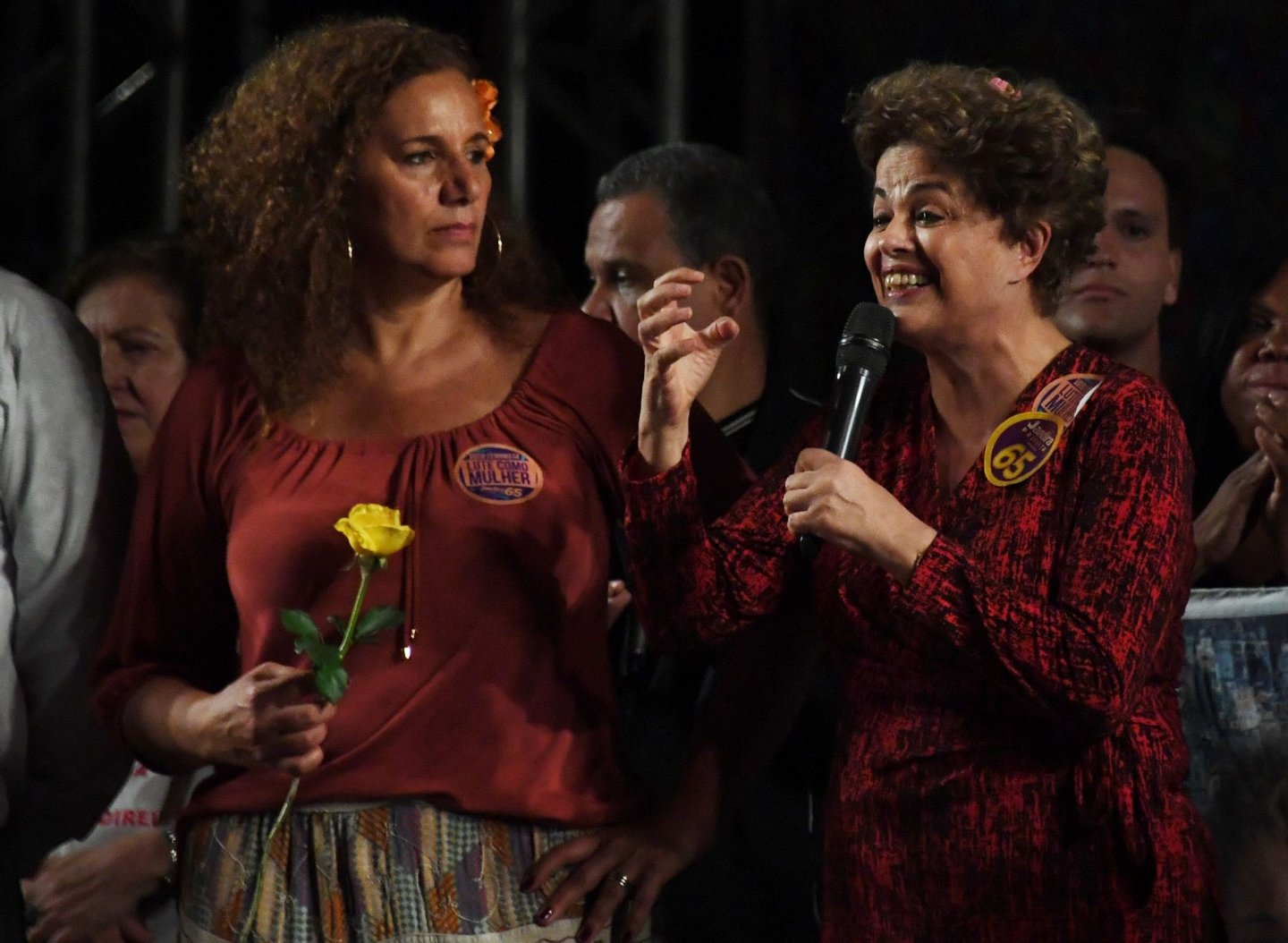 Former Brazilian president Dilma Rousseff (R) delivers a speech to supporters in Rio de Janeiro on September 21, 2016 during a campaign rally for Jandira Feghali (L), Communist Party candidate for mayor of Rio de Janeiro. / AFP / VANDERLEI ALMEIDA (Photo credit should read VANDERLEI ALMEIDA/AFP/Getty Images)