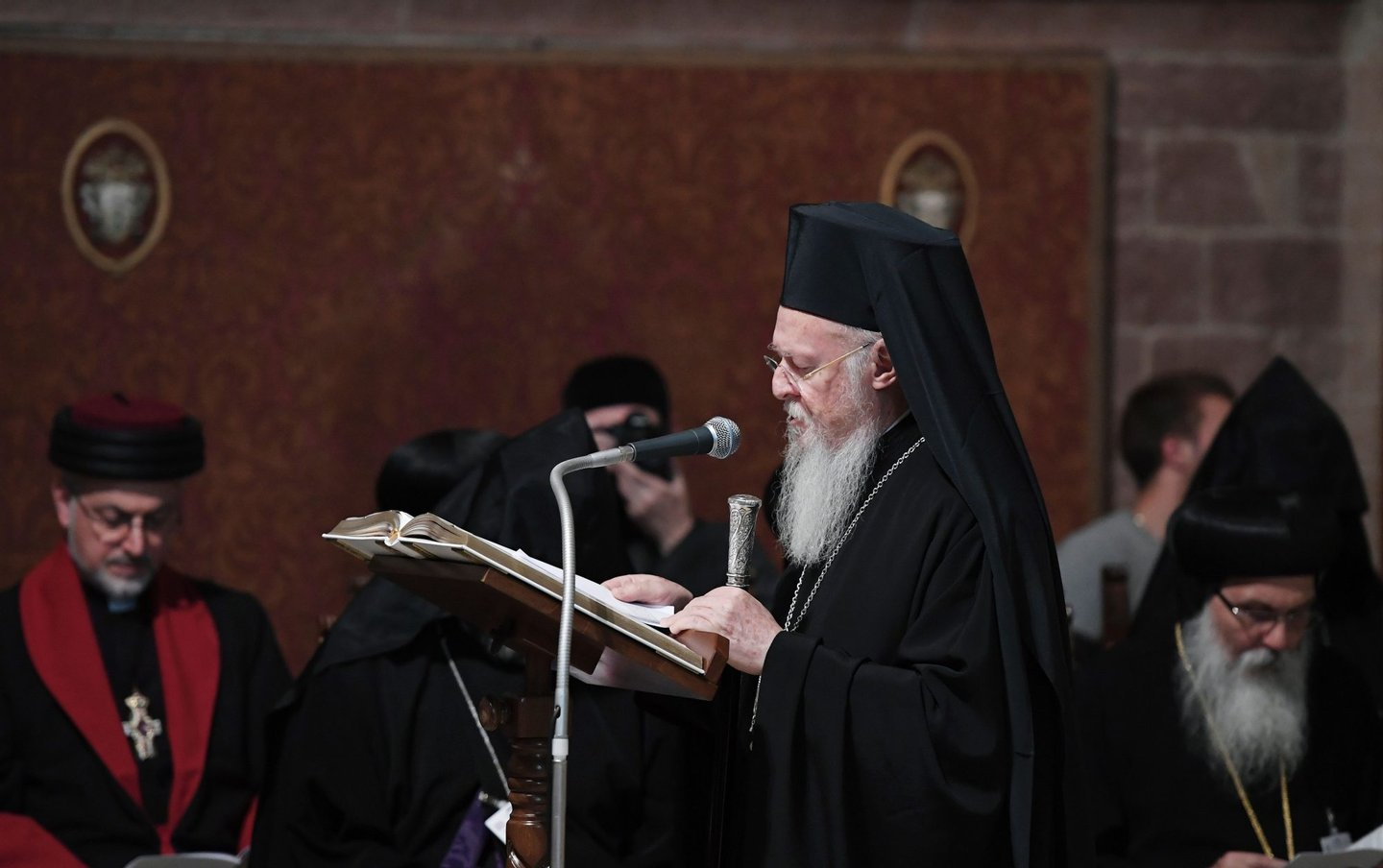 Orthodox Patriarch of Constantinople Bartholomew I prays together with representatives from different religious traditions in the St Francis basilica in Assisi on September 20, 2016. Pope Francis denounced those who wage war in the name of God, as he met faith leaders and victims of war to discuss growing religious fanaticism and escalating violence around the world. The annual World Day of Prayer event, established by John Paul II 30 years ago and held in the medieval town in central Italy, aims to combat the persecution of peoples for their faiths and extremism dressed up as religion. / AFP / TIZIANA FABI (Photo credit should read TIZIANA FABI/AFP/Getty Images)