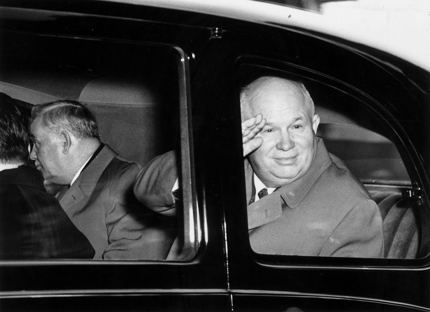 20th April 1956: First secretary of the Soviet Communist party Nikita Sergeyevich Khrushchev (1894 - 1971) greeting onlookers at the Mansion House in London. Travelling with him is Marshal Bulganin (1895 - 1975). (Photo by Fred Ramage/Keystone/Getty Images)