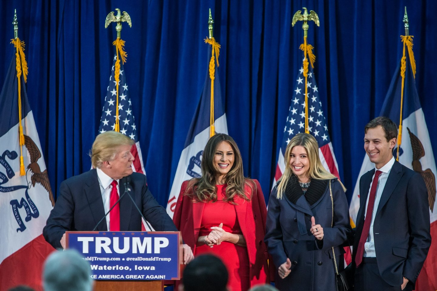 WATERLOO, IA - FEBRUARY 1: Republican presidential candidate Donald Trump (L) is joined on stage by his wife Melania Trump, daughter Ivanka Trump, and son-in-law Jared Kushner (L-R) at a campaign rally at the Ramada Waterloo Hotel and Convention Center on February 1, 2016 in Waterloo, Iowa. The Democratic and Republican Iowa Caucuses, the first step in nominating a presidential candidate from each party, will take place on February 1. (Photo by Brendan Hoffman/Getty Images)