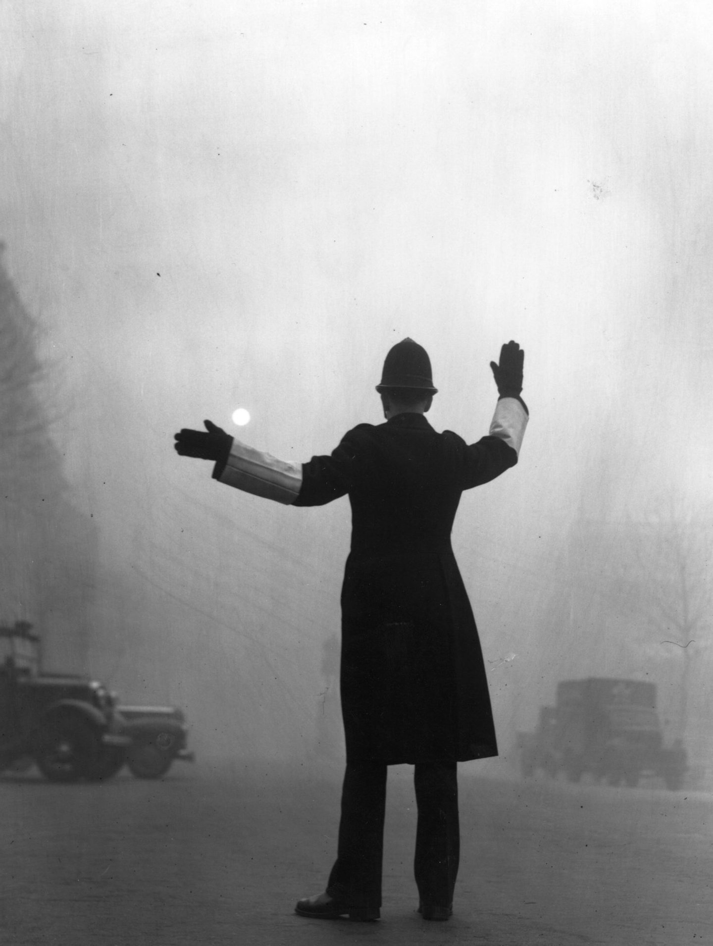 A policeman on traffic duty on a foggy day in Fleet Street, London. (Photo by Hulton Archive/Getty Images)