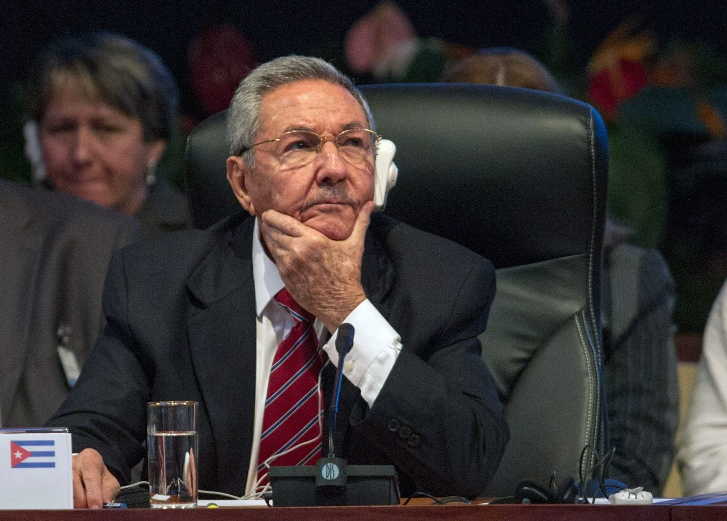 Cuban President Raul Castro listens during the opening of the Caribbean Community (CARICOM) Summit, in Havana, on December 8, 2014. The summit -- bringing together the 15 CARICOM member states and Cuba -- aims to increase trade and cooperation within the group and with Cuba. AFP PHOTO / YAMIL LAGE (Photo credit should read YAMIL LAGE/AFP/Getty Images)