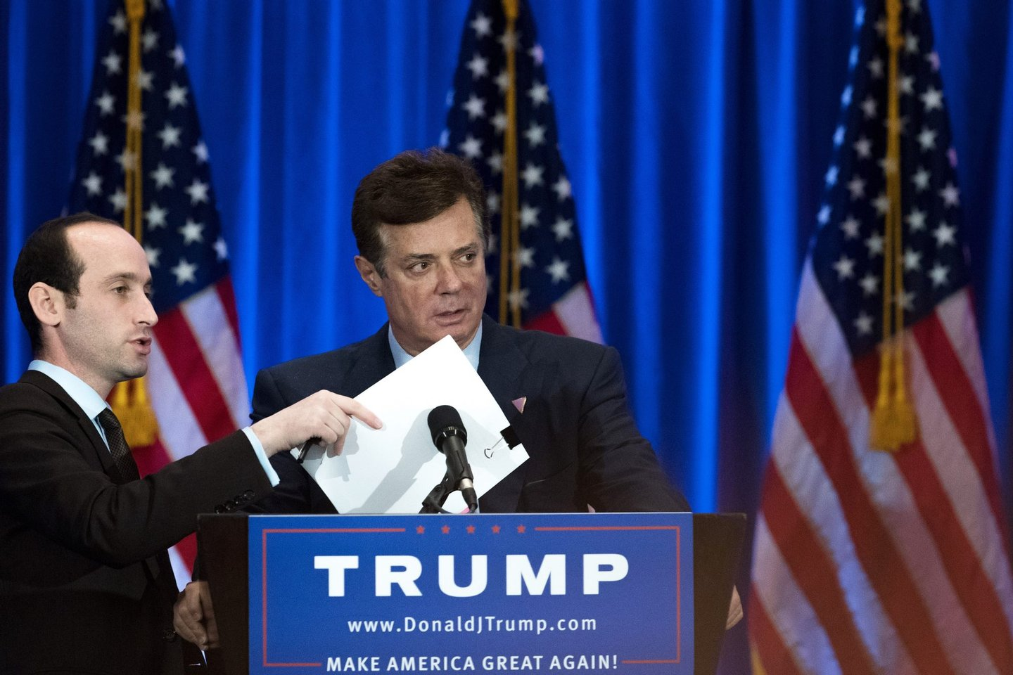 NEW YORK, NY - JUNE 22: Campaign chairman Paul Manafort checks the podium before Republican Presidential candidate Donald Trump speaks during an event at Trump SoHo Hotel, June 22, 2016 in New York City. Trump's remarks focused on criticisms of Democratic presidential candidate Hillary Clinton. (Photo by Drew Angerer/Getty Images)