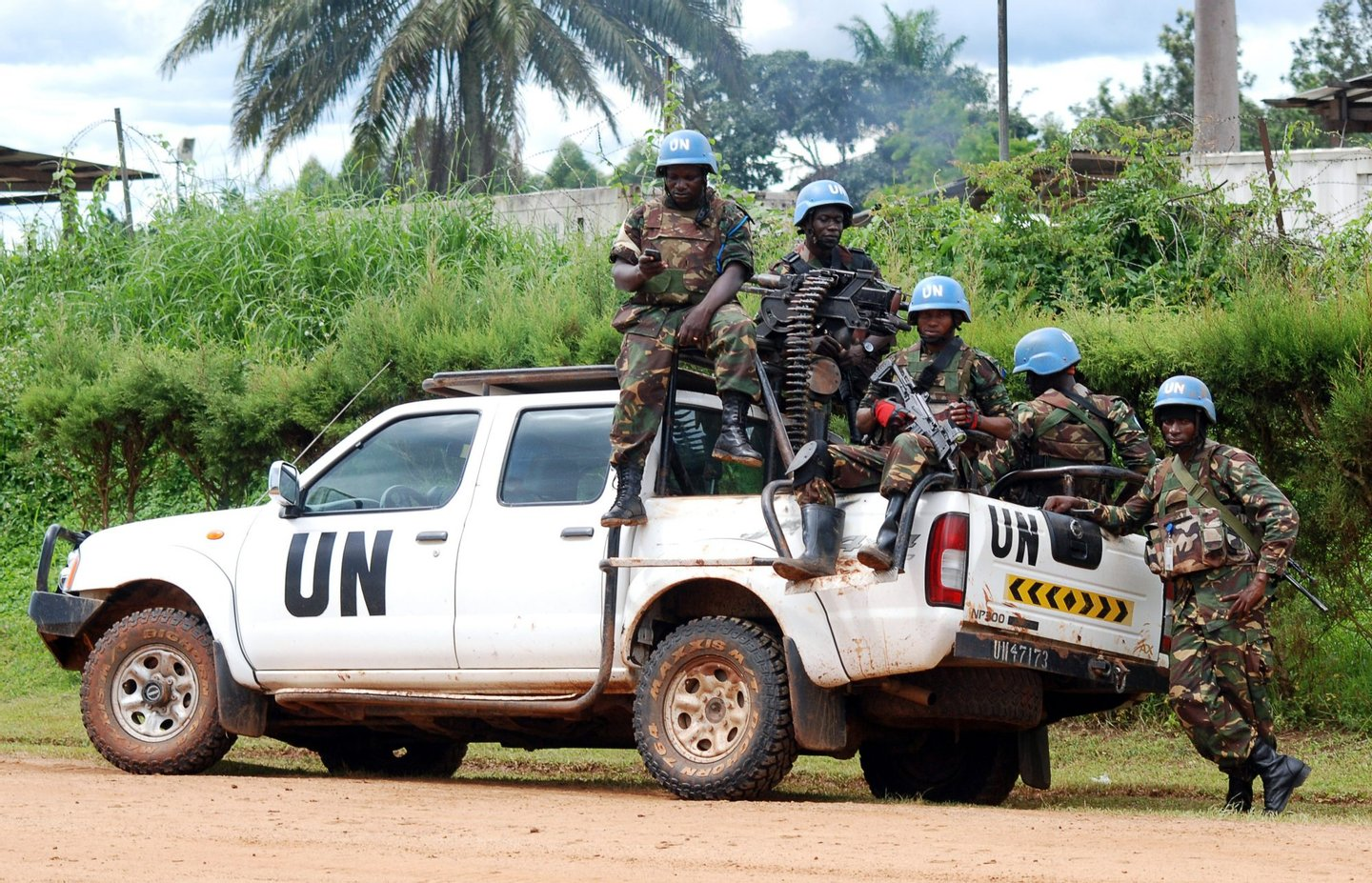 Blue helmet members of the United Nations Organization Stabilization Mission in the Democratic Republic of Congo MONUSCO sit on the back of a UN pick-up truck on October 23, 2014 in Beni. Several violent protests have erupted since October 21 in the east of the Democratic Republic of Congo to demand the departure of MONUSCO, accused of failing to prevent recent massacres in the Beni territory, attributed to Islamist Ugandan rebels of the Allied Democratic Forces (ADF), in which 80 civilians were killed in less than two weeks. AFP PHOTO / ALAIN WANDIMOYI (Photo credit should read ALAIN WANDIMOYI/AFP/Getty Images)