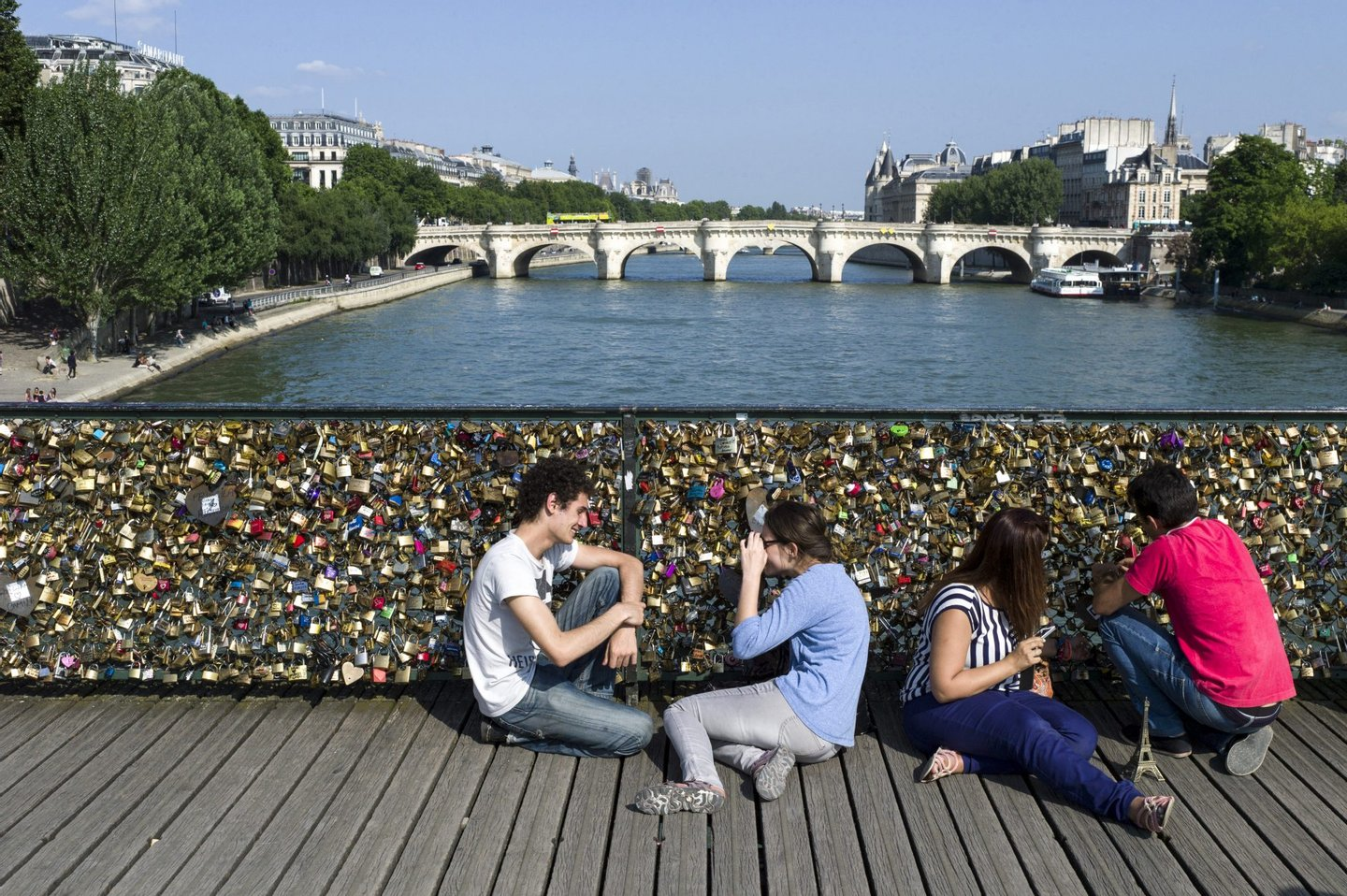 """People gather at the """"Pont des Arts"""" bridge on July 5, 2013 in Paris. AFP PHOTO / FRED DUFOUR (Photo credit should read FRED DUFOUR/AFP/Getty Images)"""