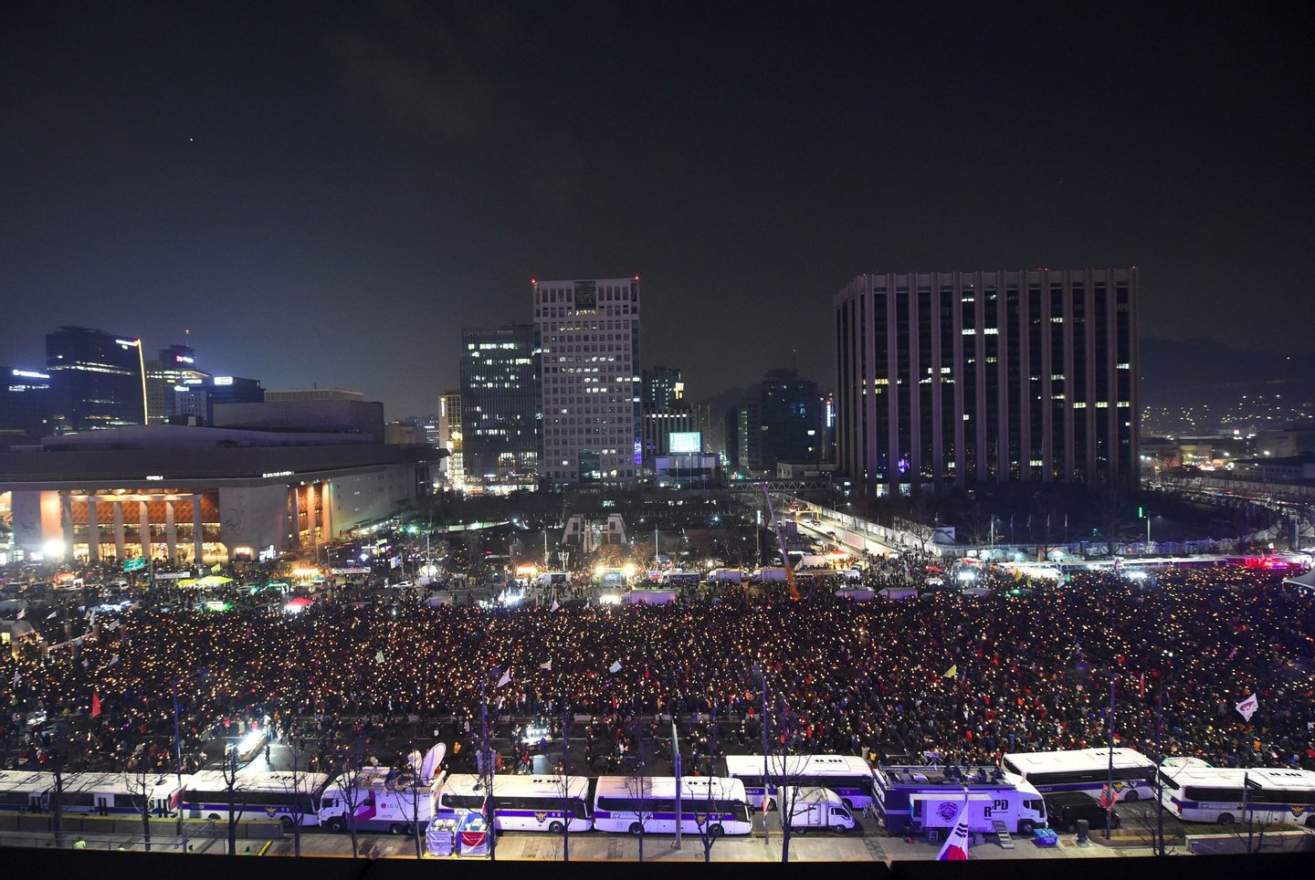 Protesters attend a candle-lit rally calling for South Korean President Park Geun-Hye's immediate departure from her office, in downtown Seoul on December 31, 2016. South Korea sees in the new year with a massive protest calling for an immediate arrest of impeached President Park Geun-Hye. / AFP / JUNG Yeon-Je (Photo credit should read JUNG YEON-JE/AFP/Getty Images)