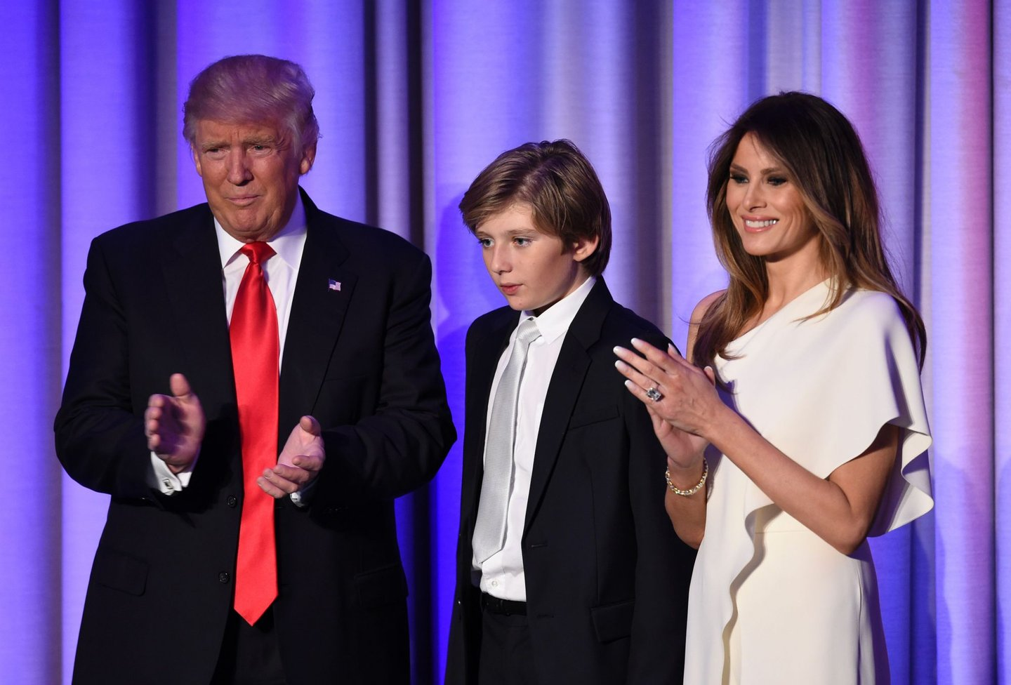 TOPSHOT - US President-elect Donald Trump arrives with his son Baron and wife Melania at the New York Hilton Midtown in New York on November 8, 2016. Trump stunned America and the world Wednesday, riding a wave of populist resentment to defeat Hillary Clinton in the race to become the 45th president of the United States. / AFP / SAUL LOEB (Photo credit should read SAUL LOEB/AFP/Getty Images)