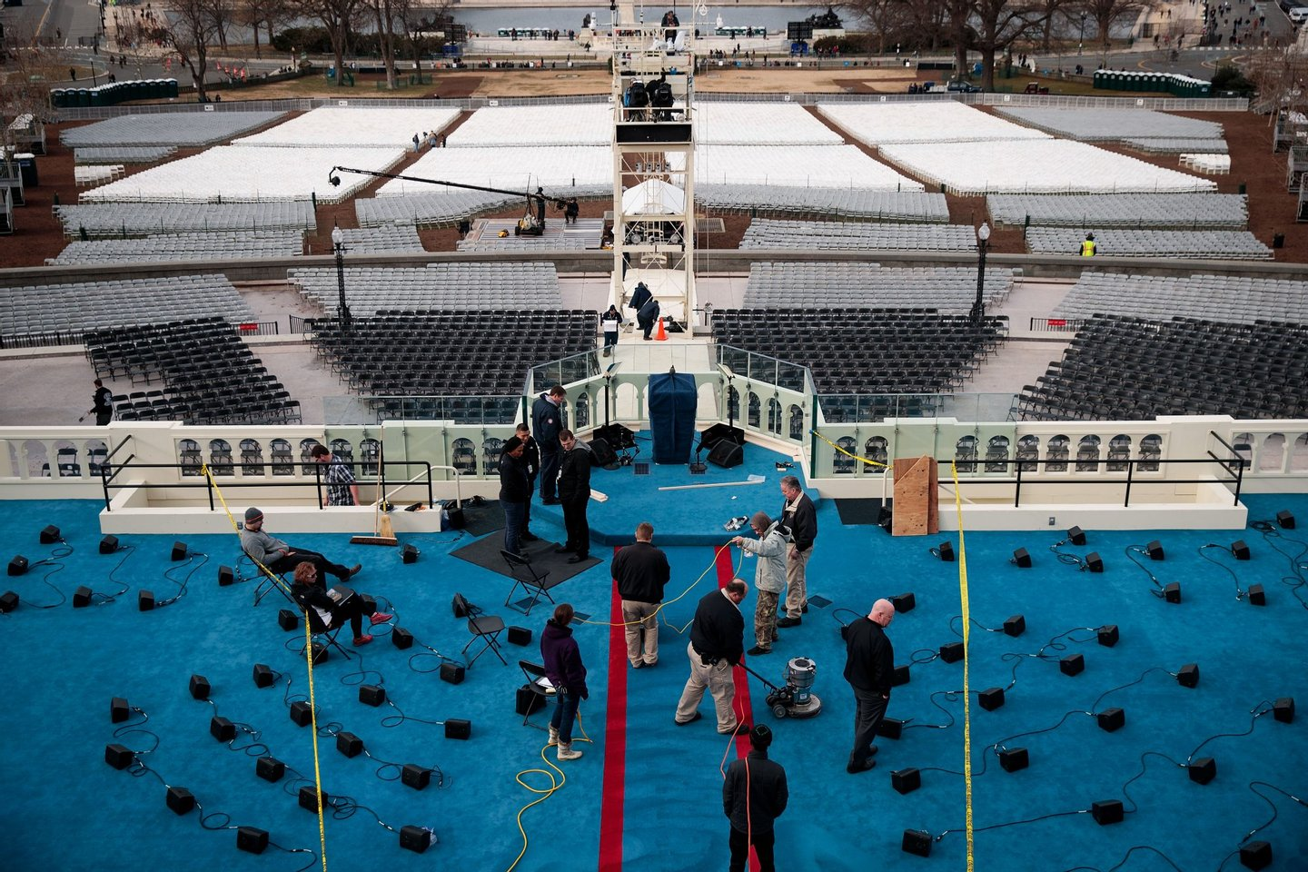 WASHINGTON, DC - JANUARY 19: Workers prepare the platform stage on the West Front of the U.S. Capitol one day before the presidential inauguration, January 19, 2017 in Washington. DC. Trump will be inaugurated as the 45th U.S. President on Friday. (Photo by Drew Angerer/Getty Images)