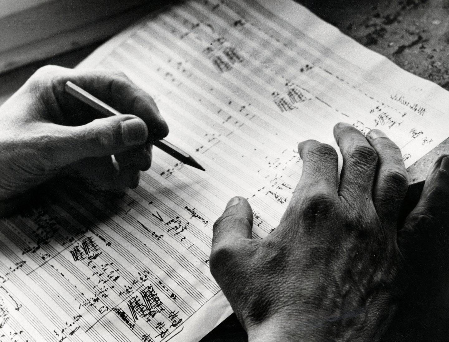 The German composer Carl Orff at work on a score