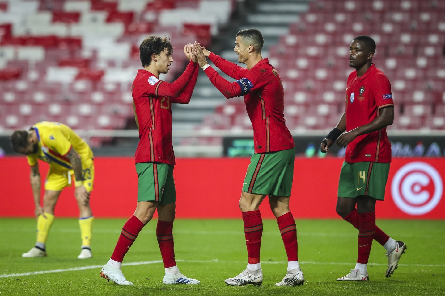 Portugal national team player Joao Felix (C-L) and Cristiano Ronaldo (C-R) celebrate after scoring a goal during the friendly soccer match between Portugal and Andorra, held at Luz stadium in Lisbon, Portugal, 11 November 2020. JOSE SENA GOULAO/LUSA