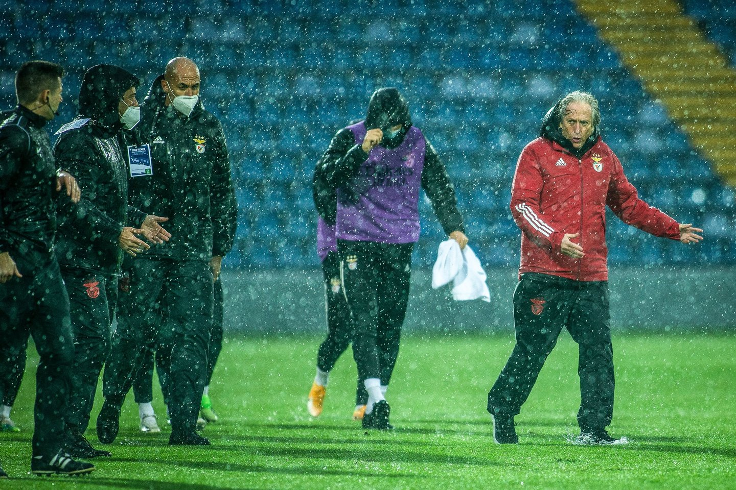 Benfica head coach Jorge Jesus (R) and his staff leave the field after ther Portuguese First League soccer match with Santa Clara was interrupted due to heavy rains at Sao Miguel Stadium, Ponta Delgada, Soa Miguel Island, Azores, 3rd January 2021. The match was interrupted and schedulled to be played tomorrow due to the heavy rains that fell this afternoon. EDUARDO COSTA/LUSA